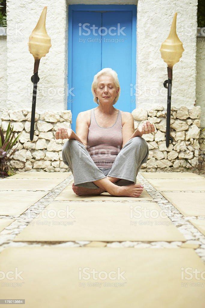 Senior Woman Meditating Outdoors At Health Spa royalty-free stock photo