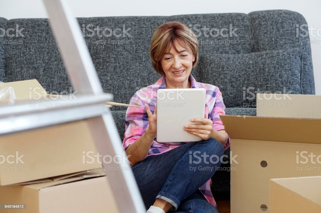 Senior woman moving into a new apartment stock photo