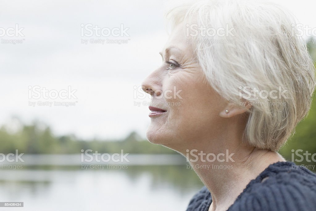 Senior woman near lake stock photo