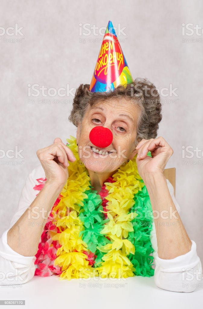 Senior Woman Of 80 Years Old Is Ready For Birthday PartyOn The Cone Translation