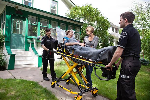 Senior Woman on Ambulance Stretcher stock photo