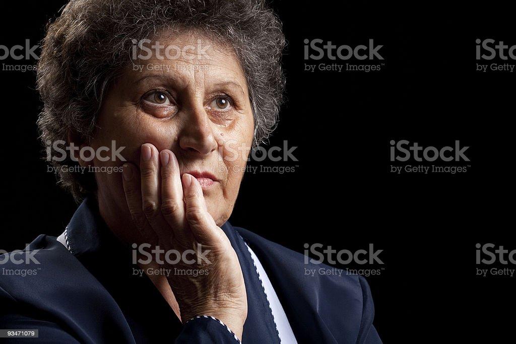 Senior woman on black royalty-free stock photo