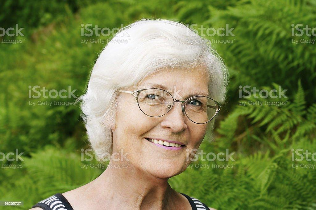 Senior woman on fern background royalty-free stock photo