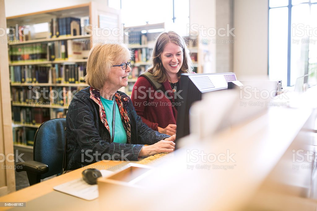 Senior Woman On Library Computer stock photo