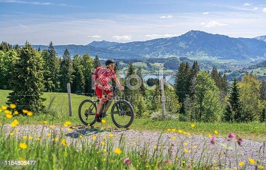 istock senior woman on mountain bike 1154808477