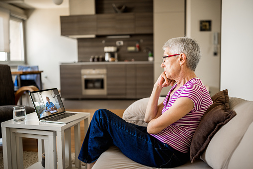 Senior woman on online therapy