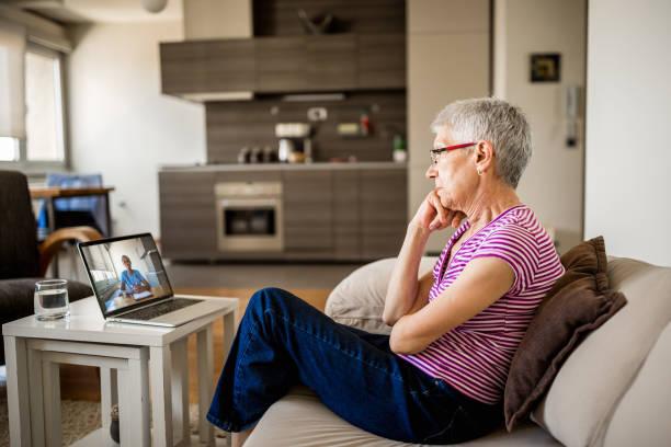 Senior woman on online therapy stock photo