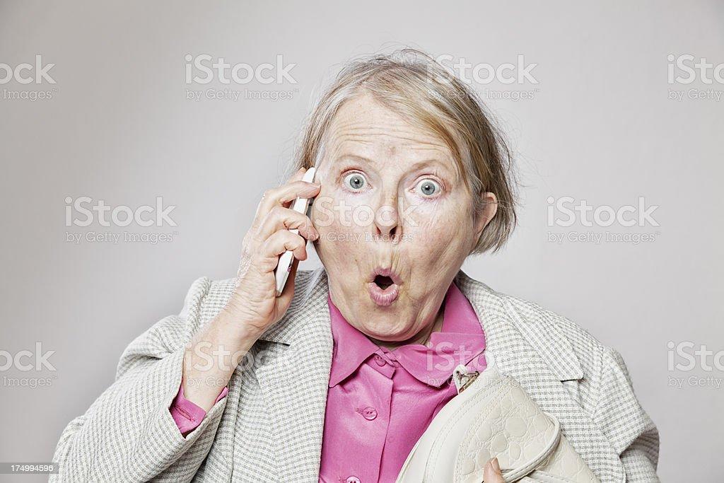 senior woman on the phone surprise royalty-free stock photo