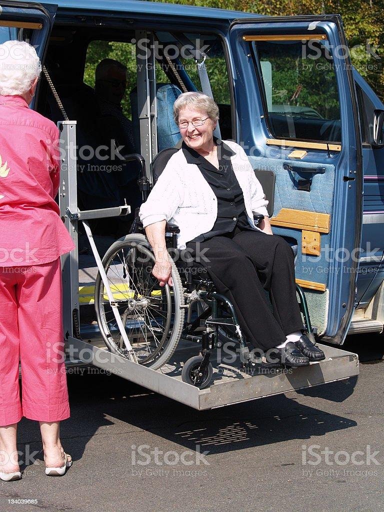 Senior Woman on Van Lift stock photo