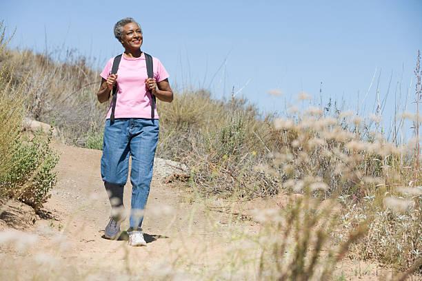 Senior woman on walk stock photo