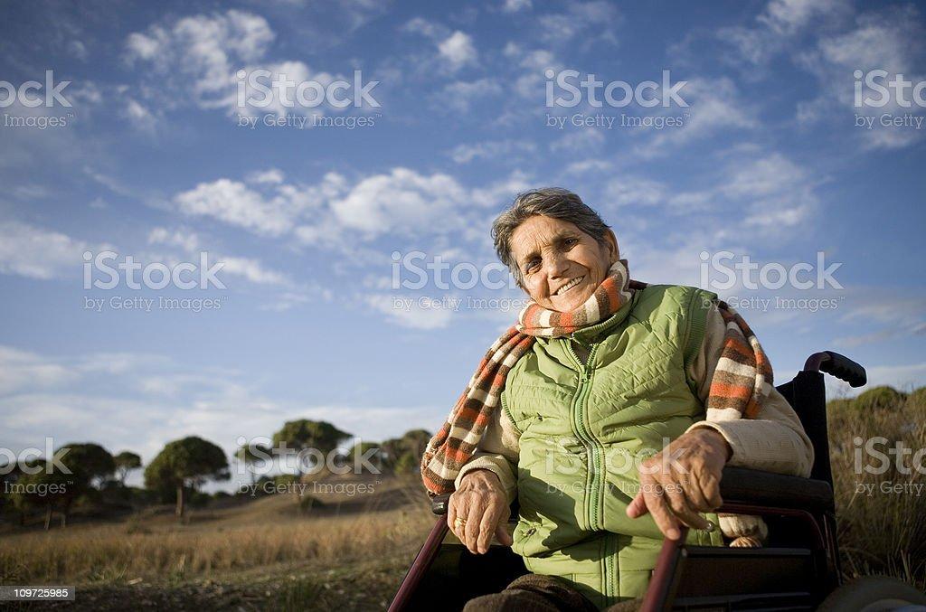 Senior woman on wheelchair royalty-free stock photo