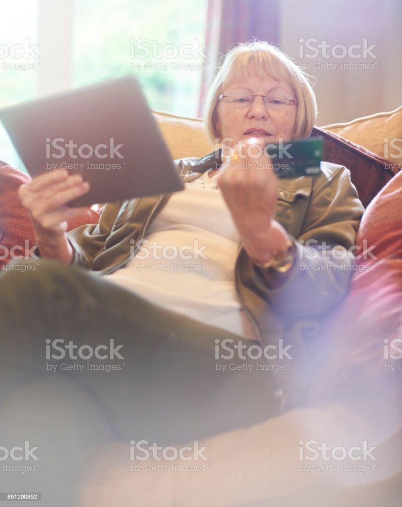 senior woman online shopping stock photo