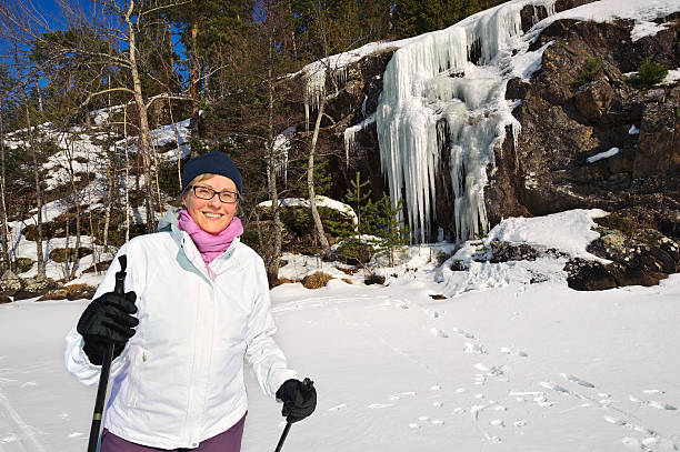 Senior woman outdoors in winter stock photo