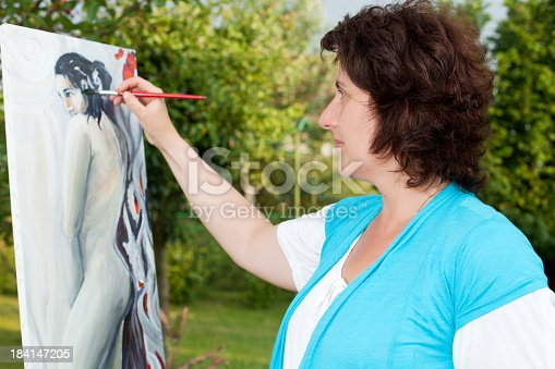 585509074 istock photo Senior woman painting in the park . 184147205