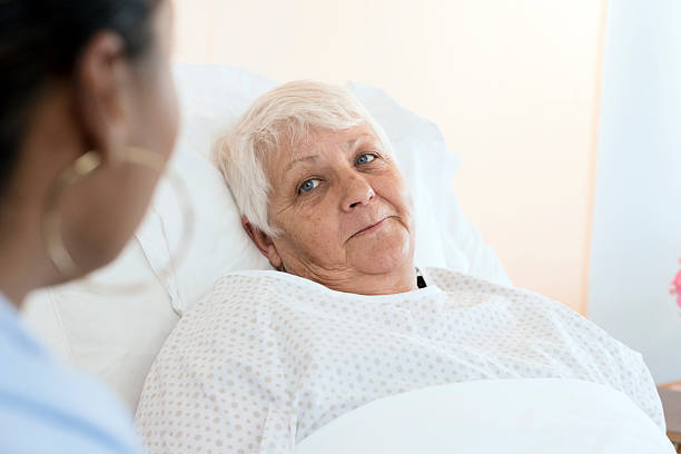 Senior Woman Patient With Female Doctor stock photo