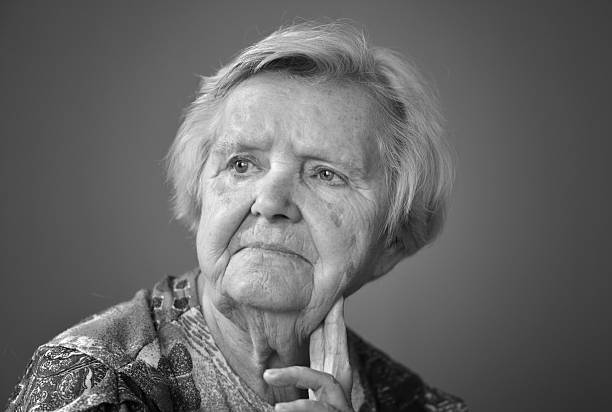 Senior woman pensive and worried. Black and white. stock photo