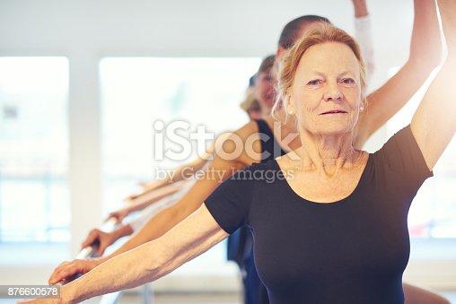 istock Senior woman performing ballet looking at camera 876600578