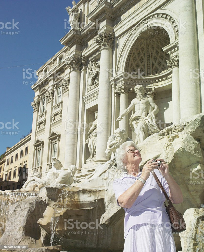 Senior woman photographing, looking up royalty-free stock photo