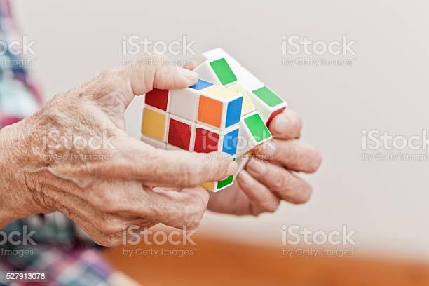 Senior woman playing a cube game picture id527913078?b=1&k=6&m=527913078&s=612x612&h=u3mjqstlki7pdsvzypwqntu8cbiphccnlhj2k hgd7q=