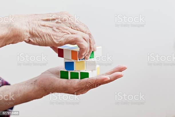 Senior woman playing a cube game picture id527913488?b=1&k=6&m=527913488&s=612x612&h=yxpehwzagmk8rhnhtao i2t n7jeqi92xetcy 1jbi0=