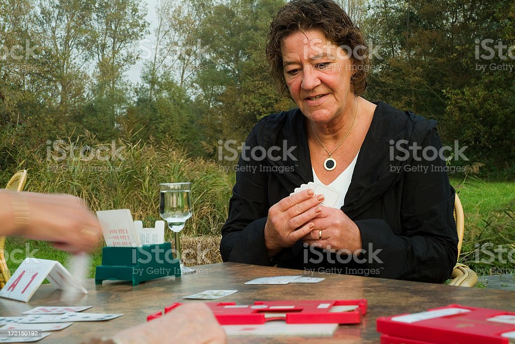 Senior woman playing bridge stock photo