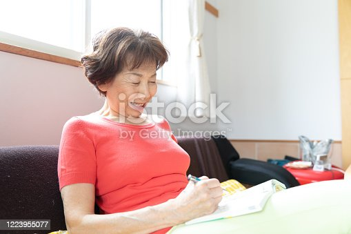 Senior woman playing reading book