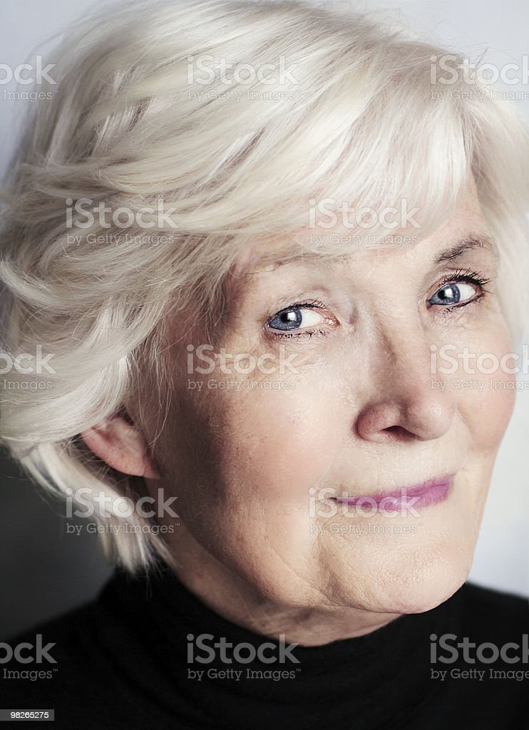 Senior woman portrait on grey background royalty-free stock photo