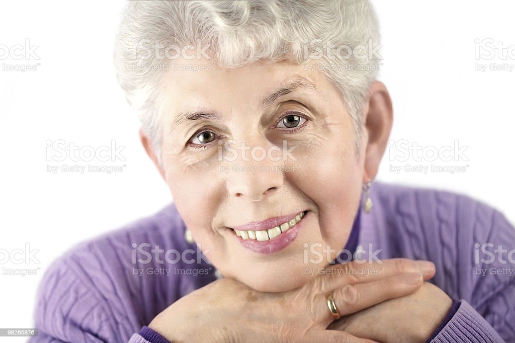 Senior woman portrait with hands under chin royalty-free stock photo