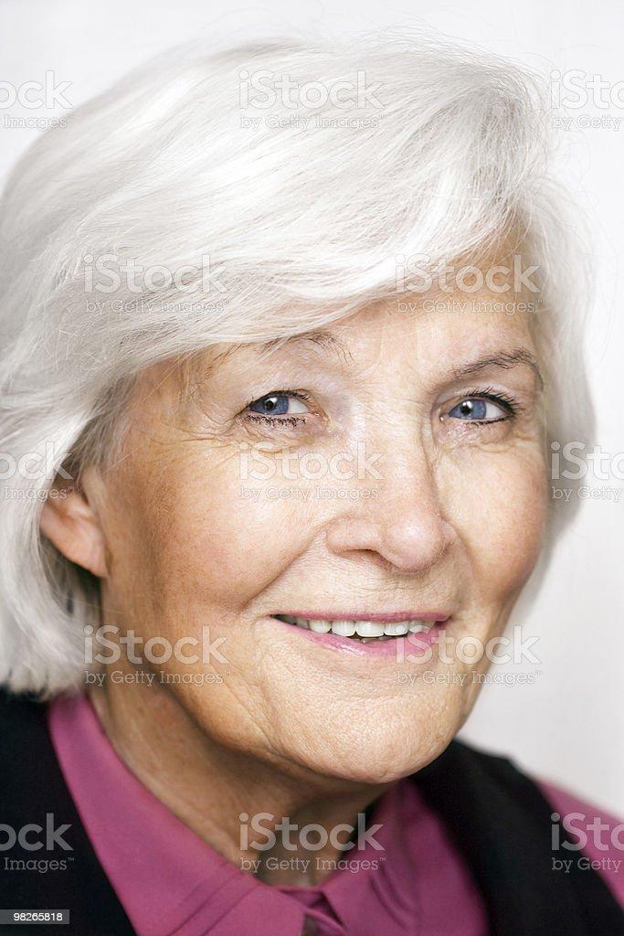 Senior woman portrait with violet blouse royalty-free stock photo