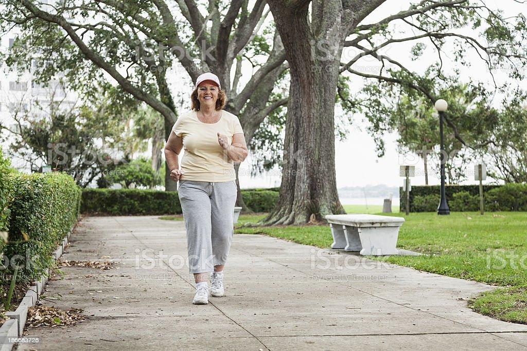 Senior woman power walking royalty-free stock photo