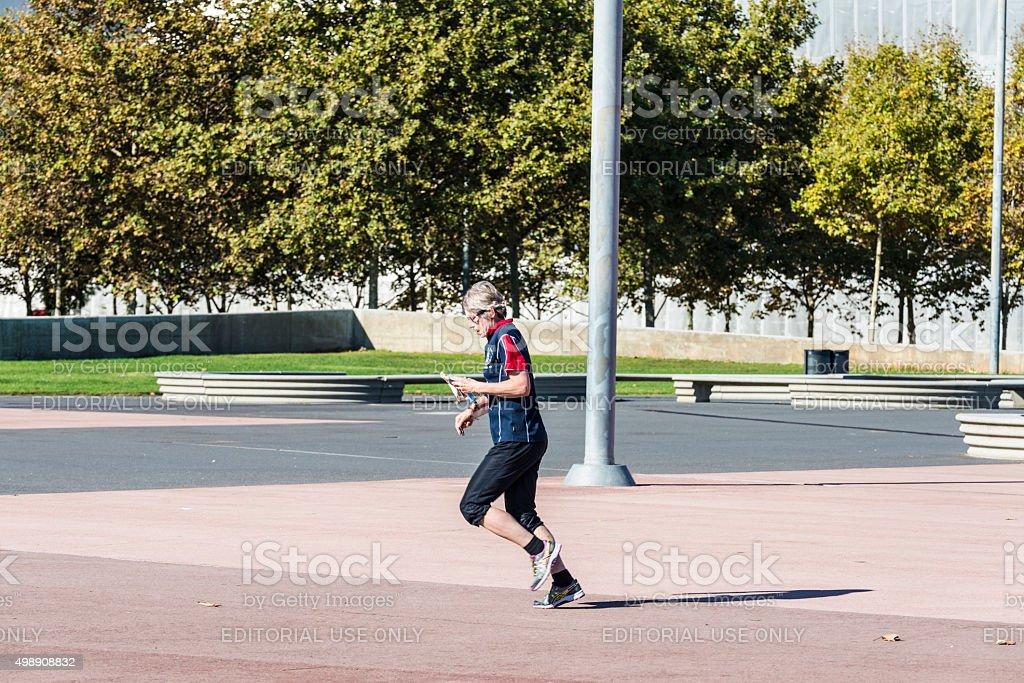 Senior woman practicing jogging in Barcelona stock photo