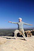 """""""A woman in her 60s practices Tai Chi on a sunny day on a rocky cliff. (El Malpais National Monument, New Mexico)."""""""