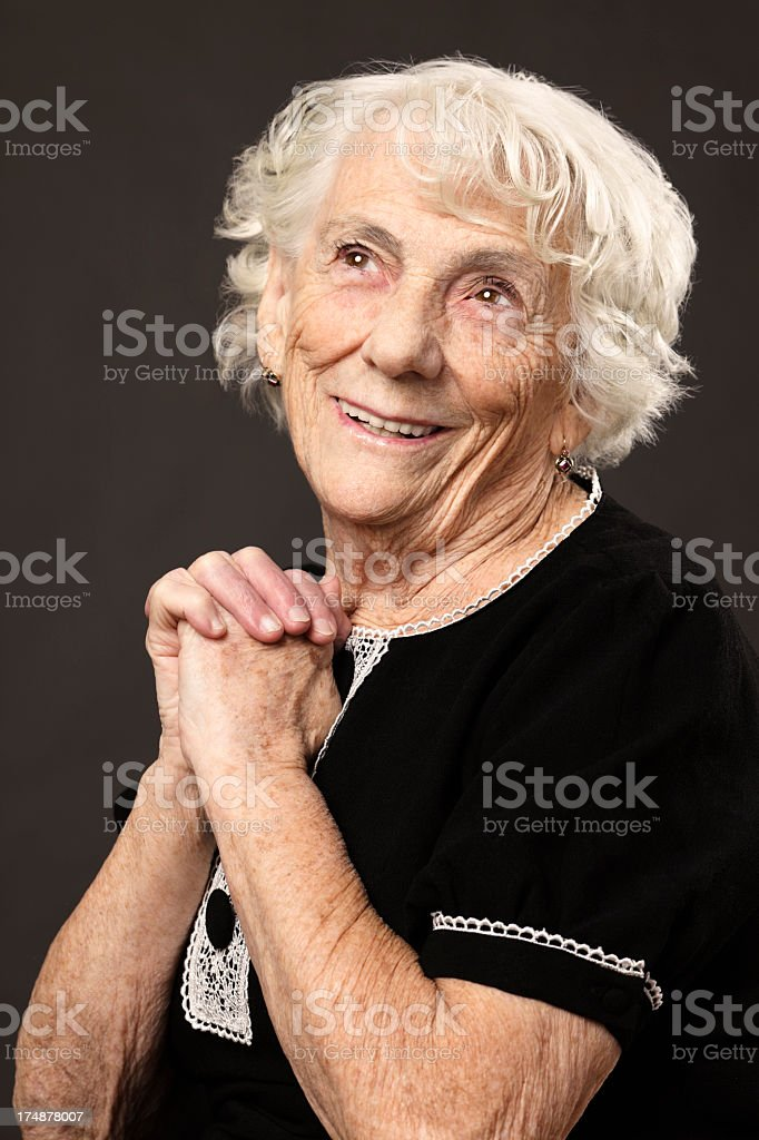 Senior woman praying royalty-free stock photo
