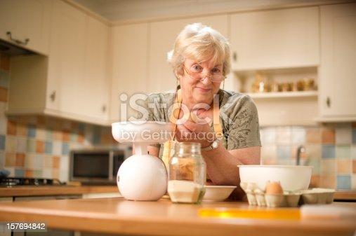 istock Senior Woman Preparing Food 157694842