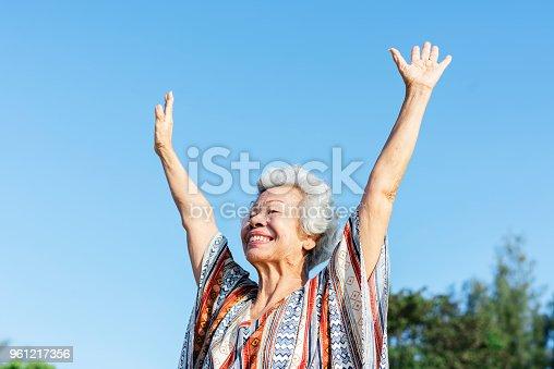 istock Senior woman raising her hands 961217356