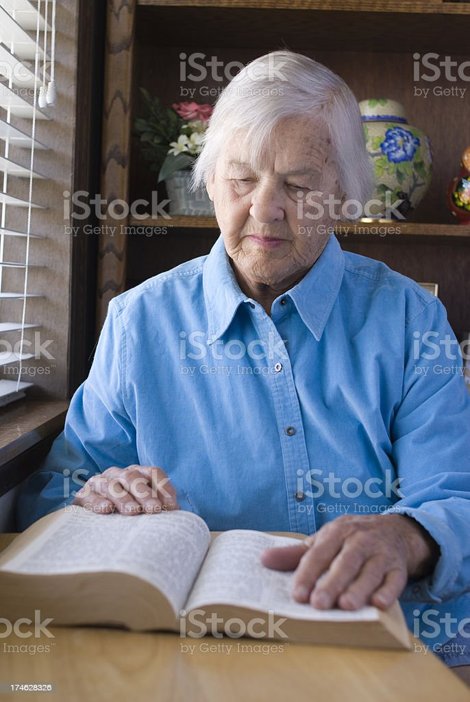 Senior woman reading bible royalty-free stock photo