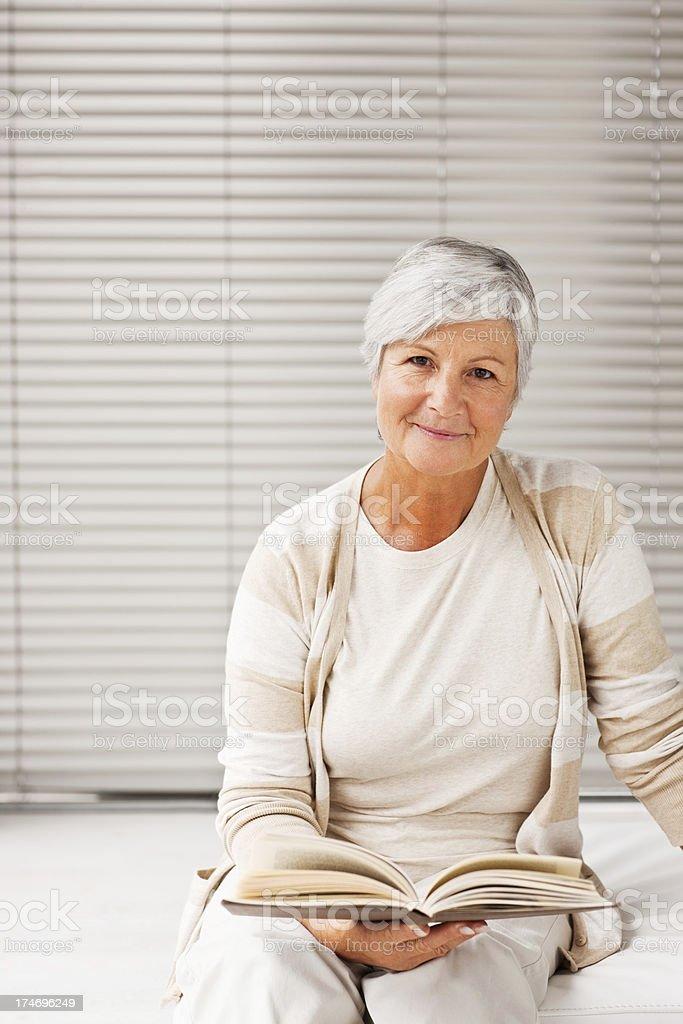 Senior woman reading book royalty-free stock photo