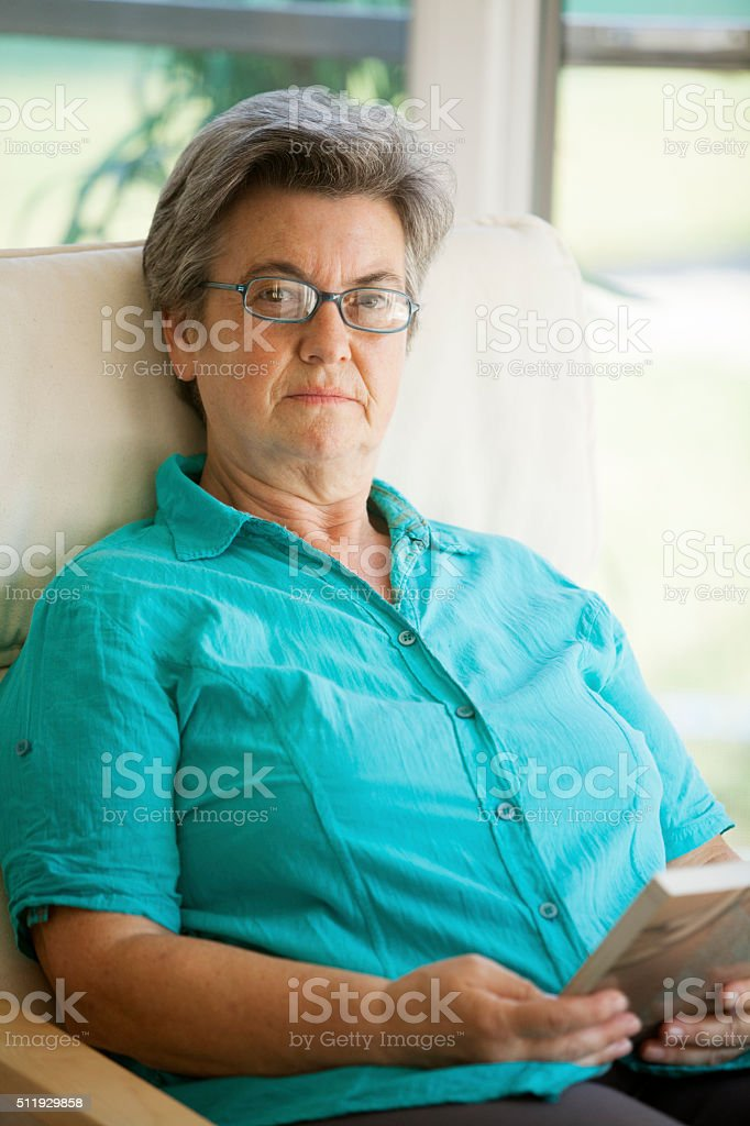 senior woman reading stock photo