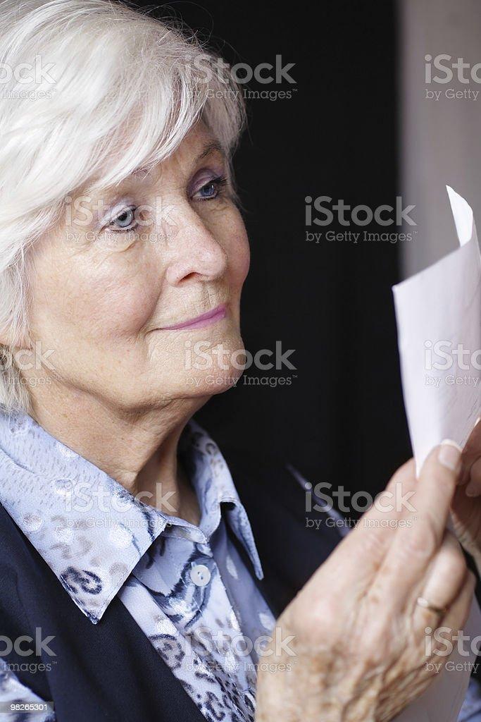 Senior woman reading royalty-free stock photo