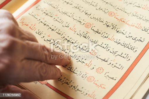 istock Senior Woman Reading the Holy Koran 1126255952
