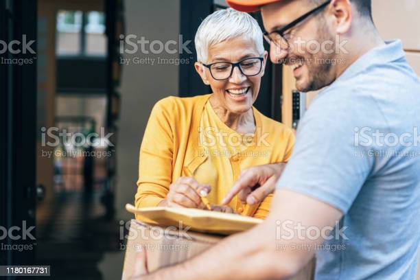 Senior woman received the parcel picture id1180167731?b=1&k=6&m=1180167731&s=612x612&h=nobgv9zmopd7r1 uydocsgyy3c5rro2qmdafw6ebube=
