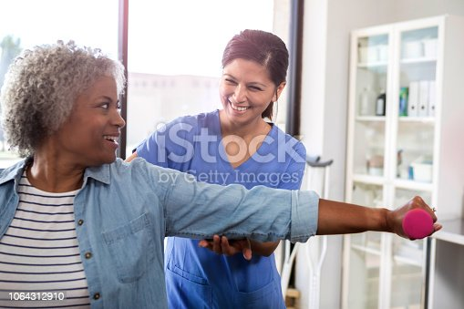 istock Senior woman receives physical therapy for arm injury 1064312910