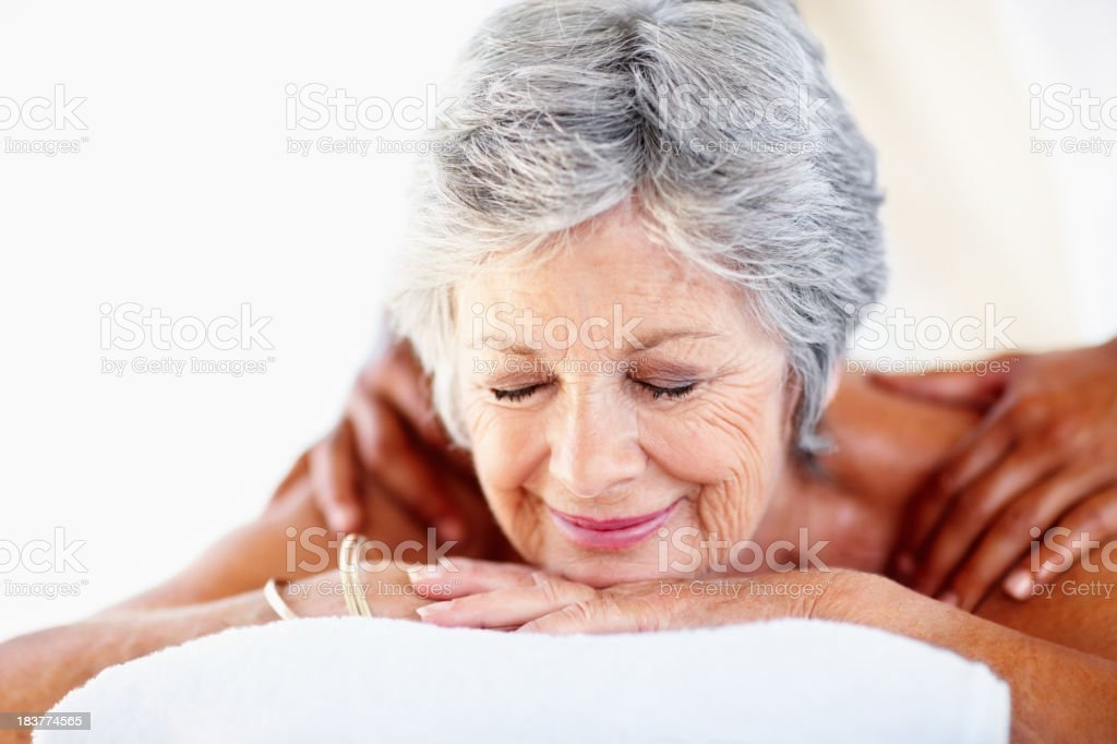 Senior woman receiving a back massage royalty-free stock photo