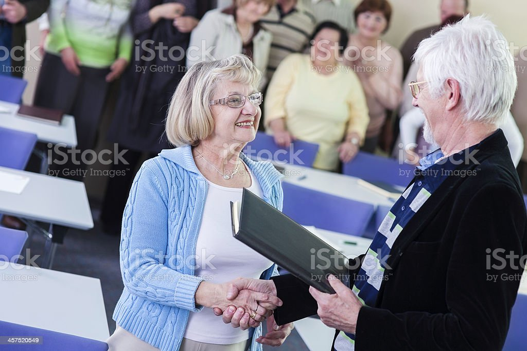 Senior woman receiving an award royalty-free stock photo