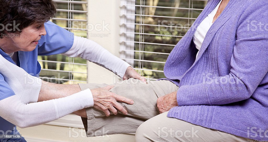 Senior woman receiving home therapy royalty-free stock photo