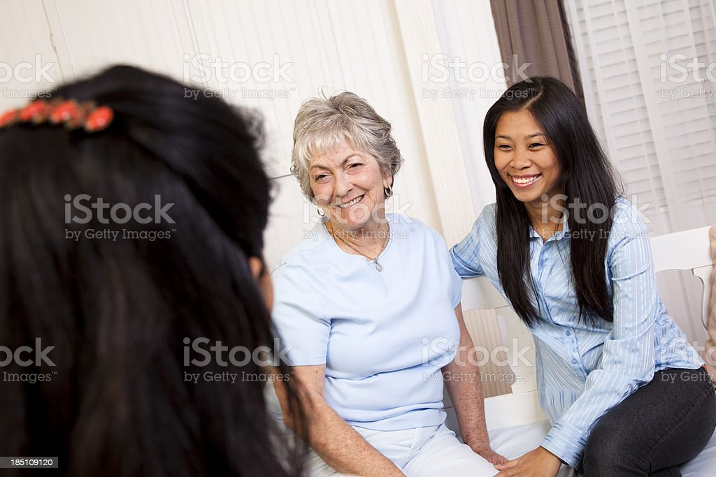 Senior woman receiving home visit from nurse royalty-free stock photo