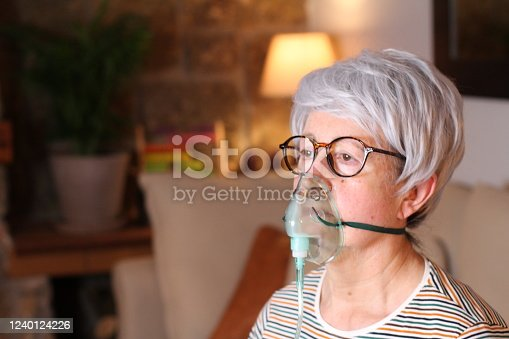 Senior woman receiving oxygen therapy.