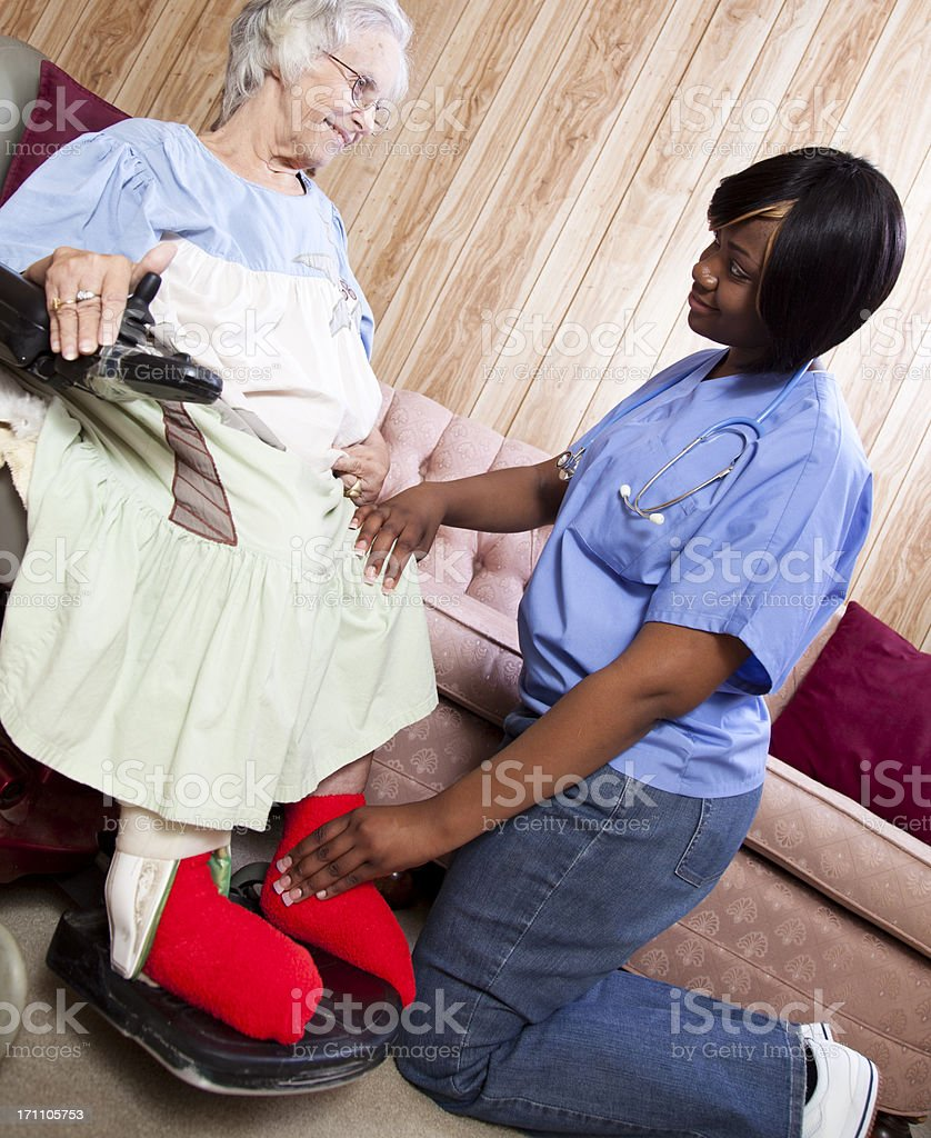 Senior woman receiving physical therapy in her home royalty-free stock photo