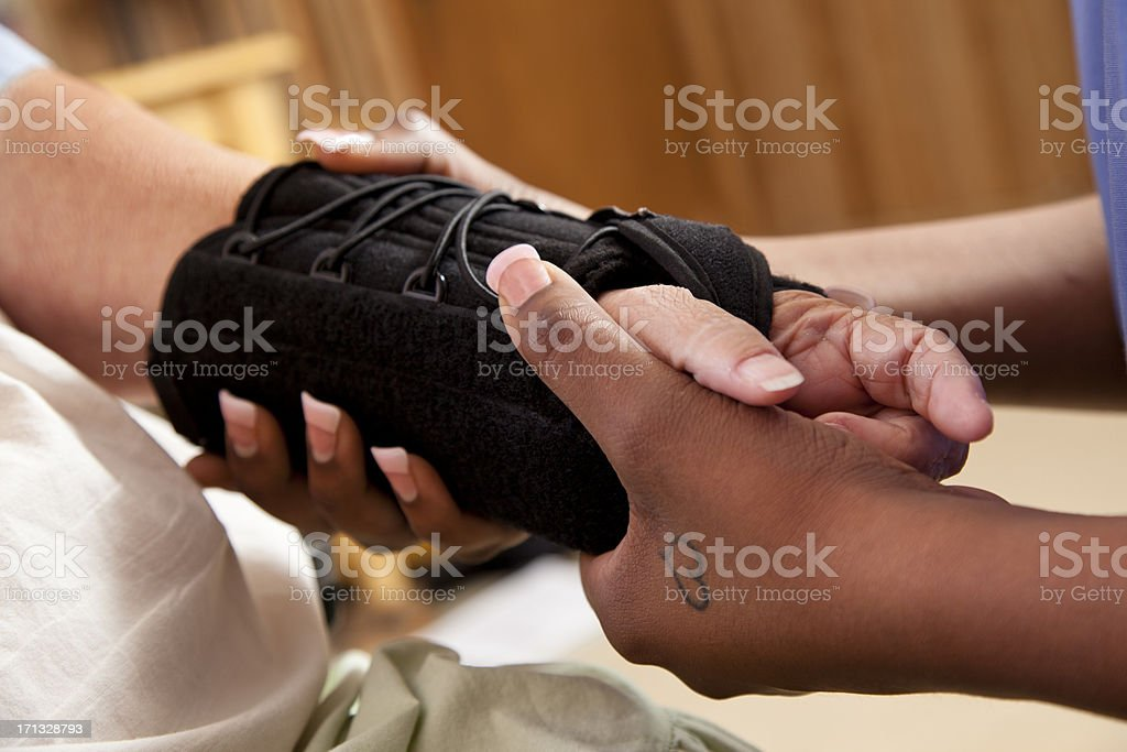 Senior woman receiving physical therapy in her home stock photo