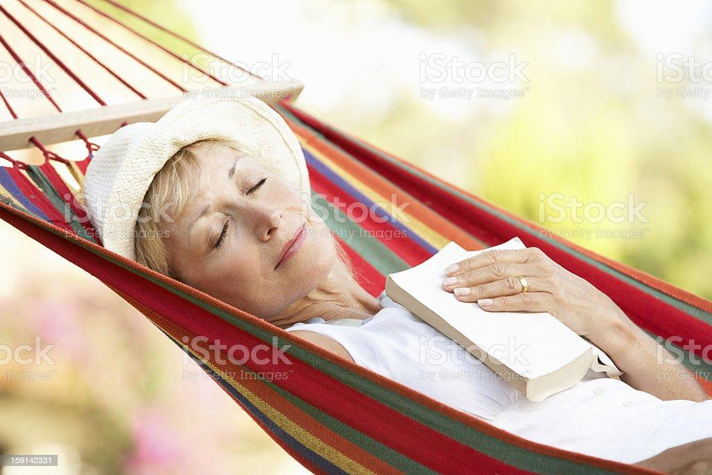 Senior Woman Relaxing In Hammock - Royalty-free 60-69 Years Stock Photo